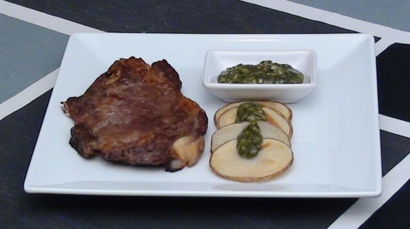 baked beef steak with potatoes and green mojo sauce